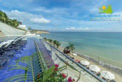 Beachfront Poseidon Hotel and Condominiums for sale pool beach area